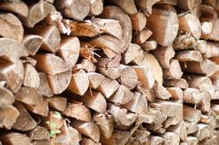 Stacked logs of firewood. Firewood Pile Background. Wood Cut Logs Backdrop Royalty Free Stock Image