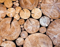 Stacked logs, wooden background Royalty Free Stock Photo