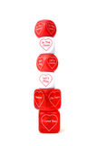 Stacked Love Dice. Dice stacked over white, valentine theme Stock Images