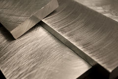 Stacked machined metal blocks. With slight warm tone royalty free stock photo