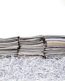 Stacked Magazines and Shredded Paper Royalty Free Stock Photos