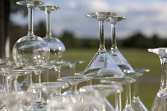 Stacked martini and wine glasses in the sun Stock Photo