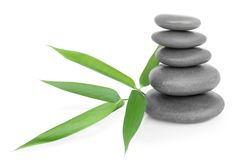 Stacked massage stones and bamboo Stock Image