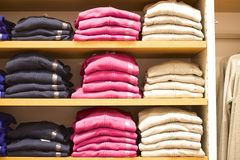 Stacked mens sweaters in retail place Royalty Free Stock Photos