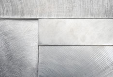 Stacked metal block background. Machined metal blocks stacked for use as background or design element stock photography