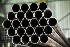 Stacked metal pipes Stock Photos