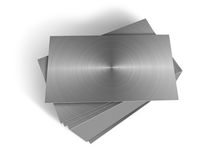 Stacked metal plates. On a white background Stock Photography