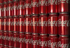 Stacked 375ml Coca-Cola Cans. Adelaide, South Australia, Australia - October 28, 2017: Iconic soft drink known around the world as Coke. Coca-Cola 375ml cans Stock Photos