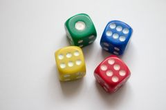 Stacked Multicoloured one and sixes Close Up. Multicoloured Dice on White Background Stock Image