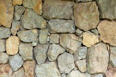 Stacked natural field rock wall background stock photos