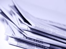 Stacked Newspapers stock image