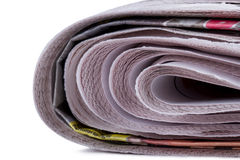 Stacked Newspapers Detail. Close up view of stacked newspapers, isolated on white background Stock Photos