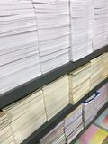 Stacked Notebooks on Shelves. Perspective Stacked Notebooks on Shelves Royalty Free Stock Images