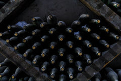 Stacked of old bottles in the cellar Stock Photo