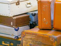 Stacked old suitcases at the airport stock images