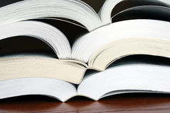 Stacked Open Books. Horizontal image of four open books stacked upon each other so their spines more or less nest into the next book Royalty Free Stock Photos