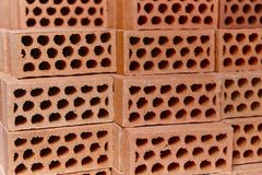 Stacked orange bricks detail. Construction industry. Masonry. Horizontal Royalty Free Stock Photography