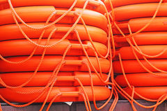 Stacked orange rescue round buoy, sea marine lifesaver Royalty Free Stock Photo