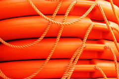 Stacked orange rescue round buoy, sea marine lifesaver. Stock Image