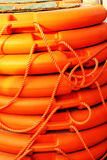 Stacked orange rescue round buoy, sea marine lifesaver Royalty Free Stock Images