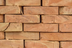 Stacked orange solid clay brick background 2 Stock Photography