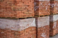 Stacked orange solid clay brick Royalty Free Stock Photography