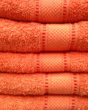 Stacked of orange towel, close up view royalty free stock images