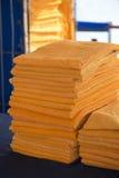Stacked orange towels Stock Image