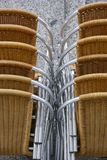Stacked outdoor metallic and plastic chairs. City background. Vertical Royalty Free Stock Images