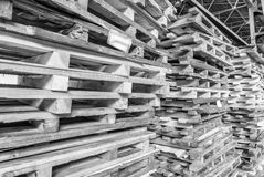 Stacked pallets inside a warehouse. Industrial concept Stock Images