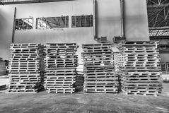 Stacked pallets inside a warehouse. Industrial concept Royalty Free Stock Photos