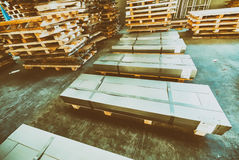Stacked pallets inside a warehouse. Industrial concept Royalty Free Stock Photo