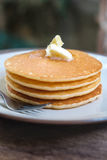 Stacked pancake on wooden table Stock Image