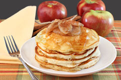 Stacked pancakes with baked apples topping. Stock Image