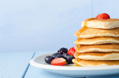 Stacked Pancakes and Fruit with Maple Syrup stock photography