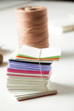Stacked Papers And Thread On Table Royalty Free Stock Photography