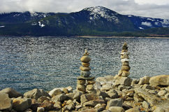 Stacked pebble on the lake shore Stock Images