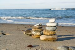 Stacked pebbles on beach Royalty Free Stock Images