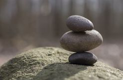 Stacked pebbles on a big rock Stock Image