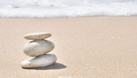 Stacked pebbles in the sand Royalty Free Stock Photo