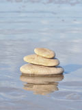 Stacked pebbles in the sea Royalty Free Stock Photography