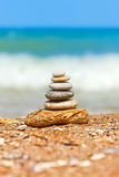 Stacked pebbles on the sea side Stock Image