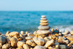 Stacked pebbles on the sea side royalty free stock images