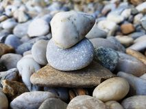 Stacked pebbles. Various stones of different shapes and sizes. Natural pebbles background. Various stones of different shapes and sizes. Outdoor decorations stock images
