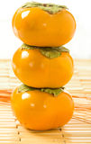 Stacked Persimmons Royalty Free Stock Photography