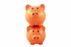 Stacked Piggy Banks Series - Orange Royalty Free Stock Photography