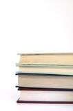 Stacked pile of books. A stacked pile of books on a white background Royalty Free Stock Image