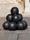 Stacked pile of old cannonballs Royalty Free Stock Photography