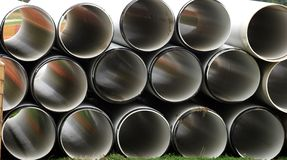 Stacked Pipes. Industrial pipes stacked in a pile stock image