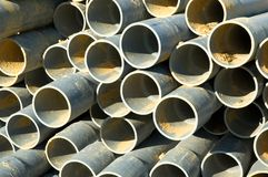 Stacked pipes. Pipes stacked on the ground stock images